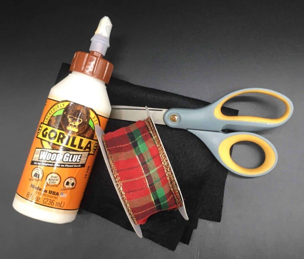 Glue, fabric, scissors, and ribbon
