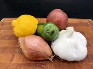 Essential Pantry - Garlic, shallots, potato, lemon, and jalapeño (Photo by Erich Boenzli)