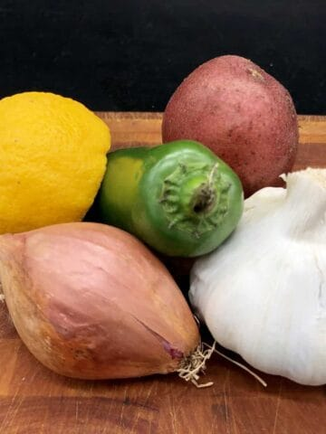 Essential Food Pantry - Garlic, shallots, potato, lemon, and jalapeño (Photo by Erich Boenzli)