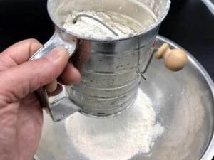 Herb Infused Ciabatta Bread - Sifting the flour (Photo by Erich Boenzli)