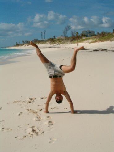 Beach Sand - Erich doing a handstand on the beach in the Bahamas (Photo by Viana Boenzli)