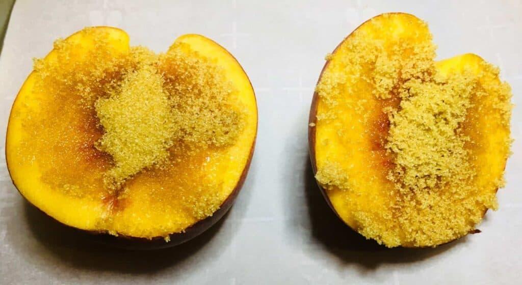 Peach Shortcake - Brown sugar on peaches, ready for the broiler (Photo by Viana Boenzli)