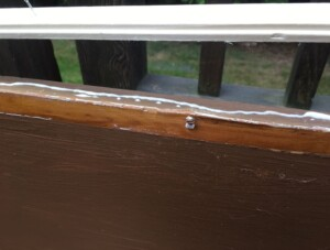 Bookcase makeover - A bead of glue to add strength to the attachment of trim (Photo by Viana Boenzli)