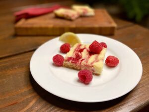 Lemon Raspberry Cheesecake Bars - You're gonna want to make extra…(Photo by Viana Boenzli)