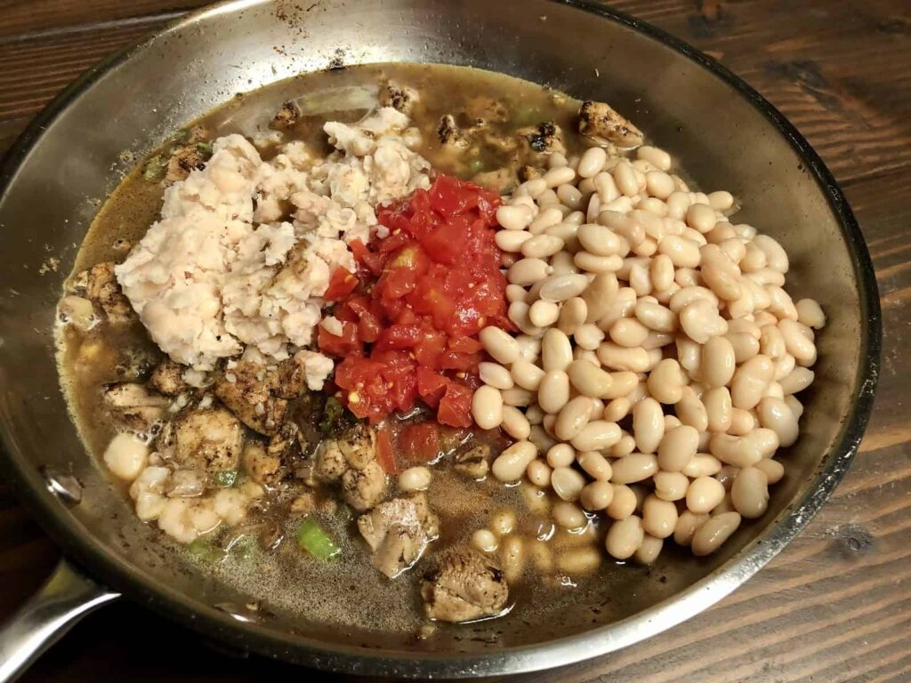 One Pan Chicken and Beans - Add mashed and whole beans, tomatoes, and stock (Photo by Erich Boenzli)