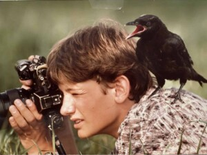 About Erich - 1983 in Switzerland, with my hand-raised Carrion Crow (Corvus corone) named Gorky