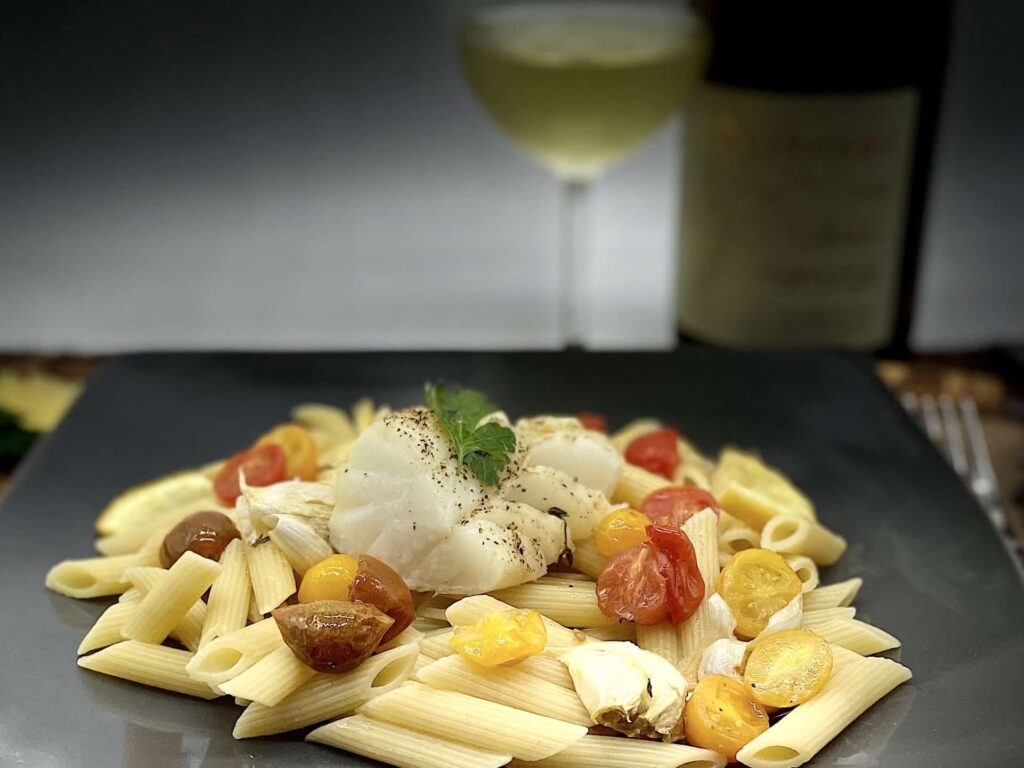 Oven Baked Cod - Delicious cod fillet with a glass of Chardonnay (Photo by Erich Boenzli)