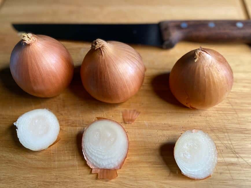 Baked Onion - Keep the ends...they're the beginning of homemade stock (Photo by Erich Boenzli)