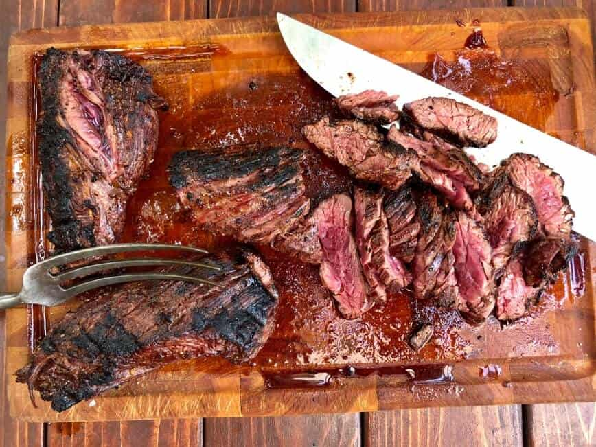 How to grill steaks - Perfectly grilled hanger steak, carved against the grain (Photo by Erich Boenzli)