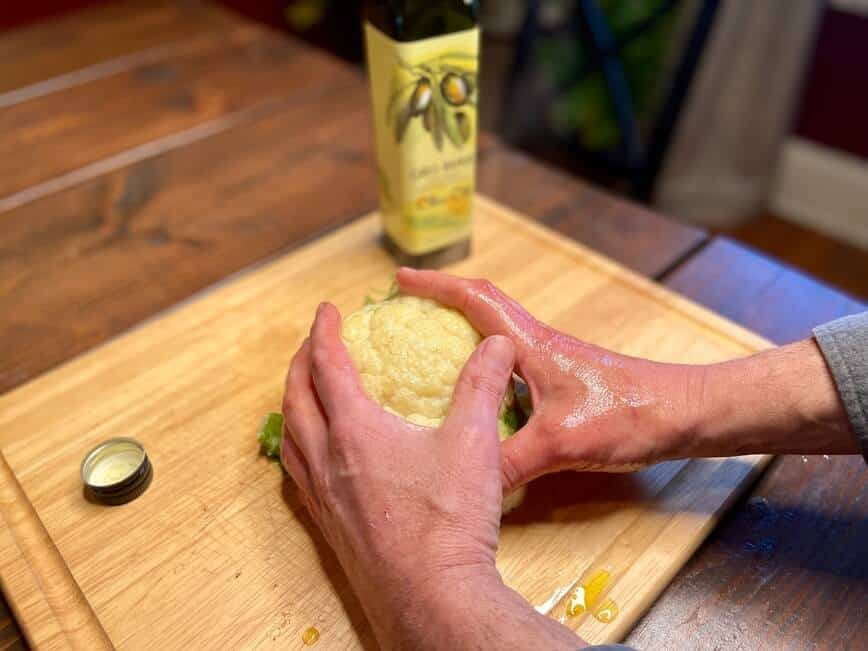 Cauliflower Rice and Oven Roasted Cauliflower - Rub olive oil all over the cauliflower (Photo by Viana Boenzli)
