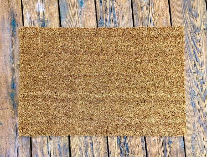 DIY Custom Painted Doormat - Plain coir doormat (Photo by Viana Boenzli)