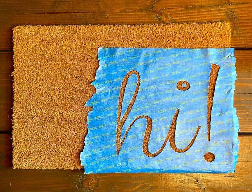 DIY Custom Painted Doormat - Painter's tape stencil cut out (Photo by Viana Boenzli)