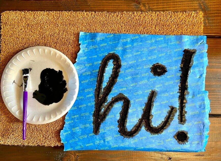 DIY Custom Painted Doormat - Apply 2 to 3 light layers of paint (Photo by Viana Boenzli)