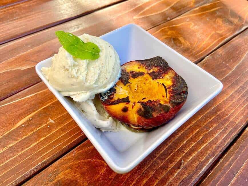 Grilling Fruits - Grilled peach with vanilla ice cream (Photo by Erich Boenzli)