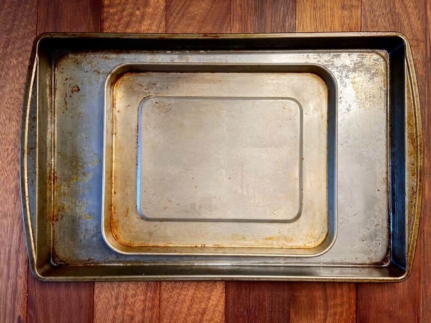 Oven Baked Salmon - Two sturdy and well-used sheet pans. One (9 x 11 in) for the toaster oven and one (11 x 17 in) for the regular oven (Photo by Erich Boenzli)