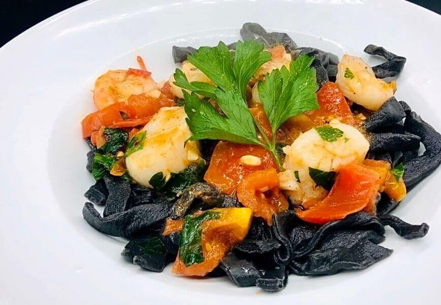 Squid Ink Pasta - Homemade Black Squid Ink Pasta with Seafood (Photo by Erich Boenzli)
