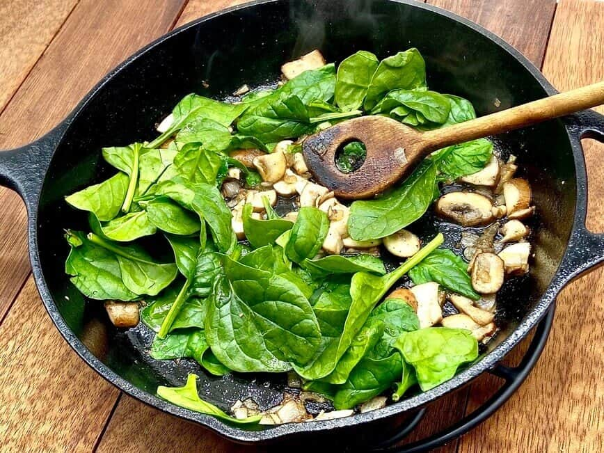 Omelette Recipe - Cooking the shallots, mushrooms, and spinach (Photo by Erich Boenzli)