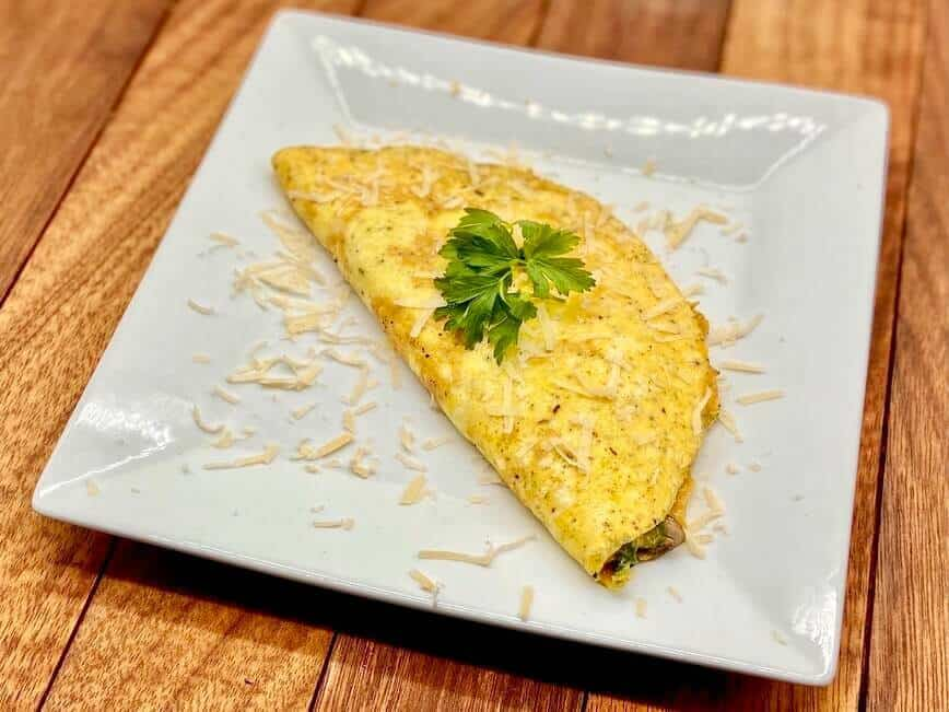 Omelette Recipe - Freshly grated Parmesan to finish it off (Photo by Erich Boenzli)