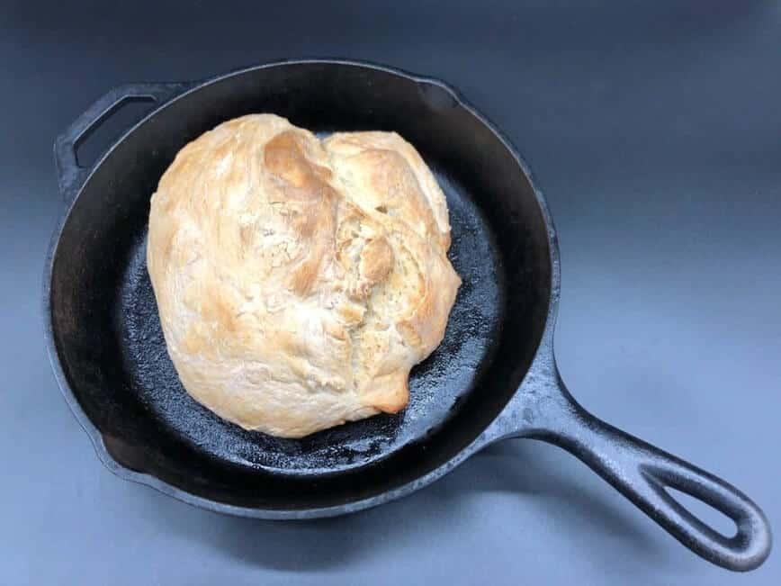 No Knead Bread - Baked bread in skillet (Photo by Erich Boenzli)