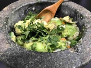 Mixing the guacamole (Photo by Erich Boenzli)