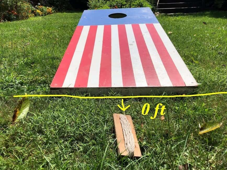 """Cornhole - Unroll the """"tape"""" from the board it's attached to (Photo by Erich Boenzli)"""